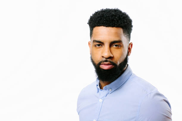 portrait of a young cool man with beard and black curly hair - carlos david stock pictures, royalty-free photos & images