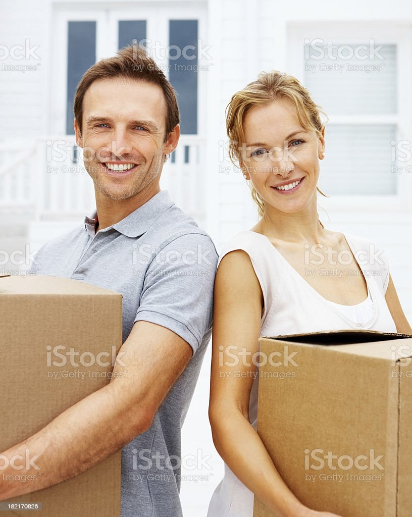 Portrait of a young couple holding cardboard box royalty-free stock photo