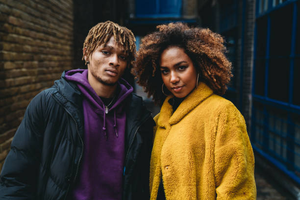 portrait of a young couple in the street - pics for cool girl stock pictures, royalty-free photos & images