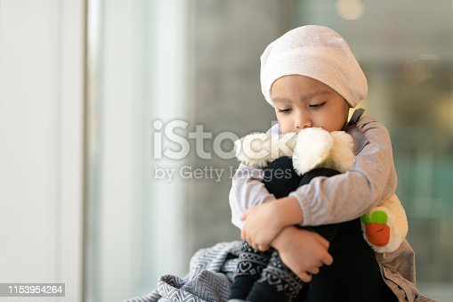 823893962 istock photo Portrait of a young ethnic girl with cancer 1153954264