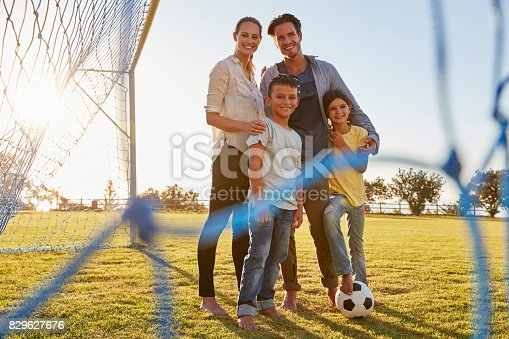 istock Portrait of a young family during a football game 829627676