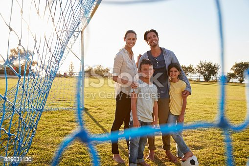 istock Portrait of a young family during a football game 829631130