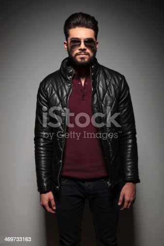 istock portrait of a young fashion man with long beard 469733163