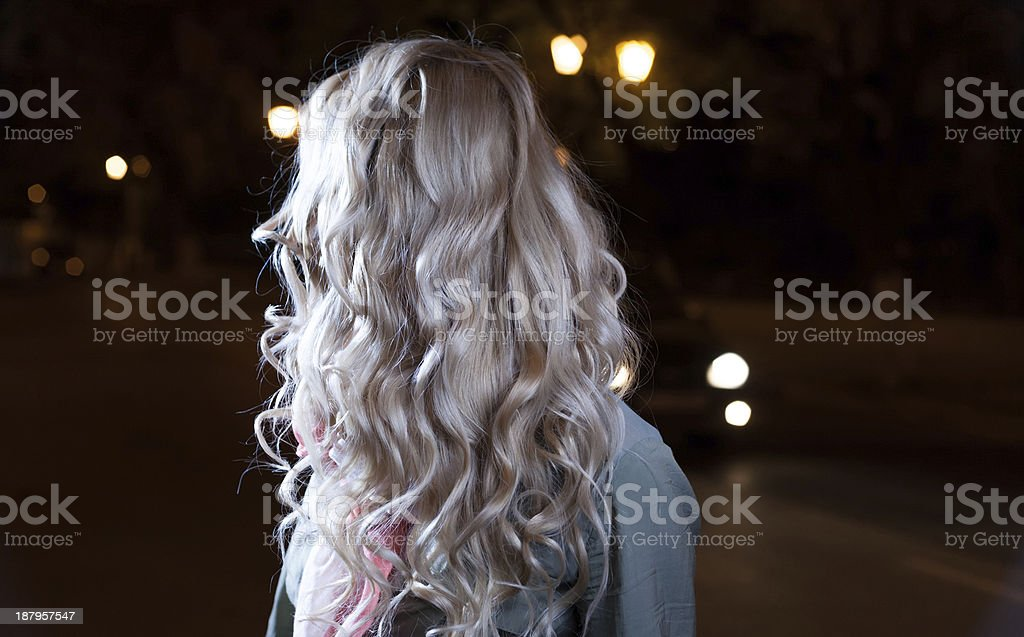Portrait of a young female businesswoman in night city. stock photo