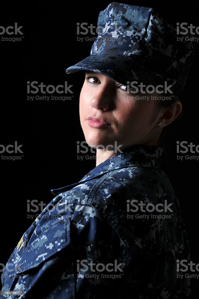 Portrait of a young female navy officer stock photo