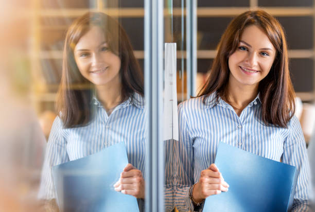 Portrait of a young female student in a coworking stock photo