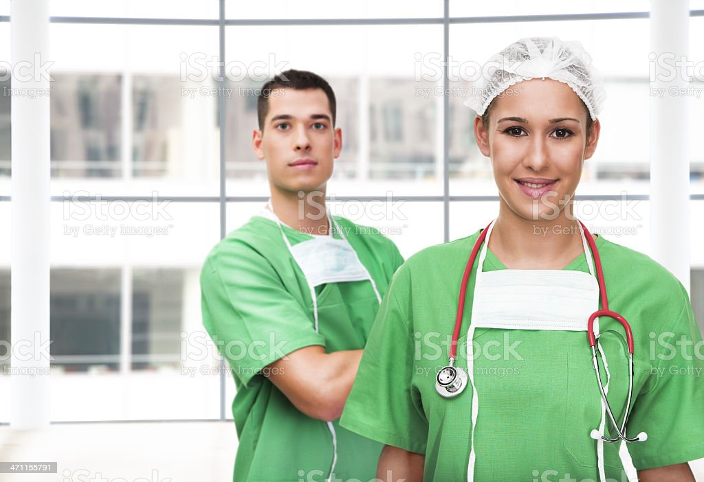 Portrait of a young female surgeon and her assistant royalty-free stock photo