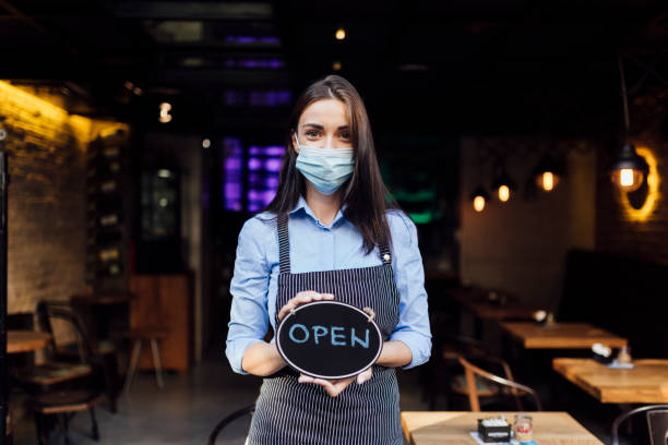 Portrait of a young female waitress stock photo