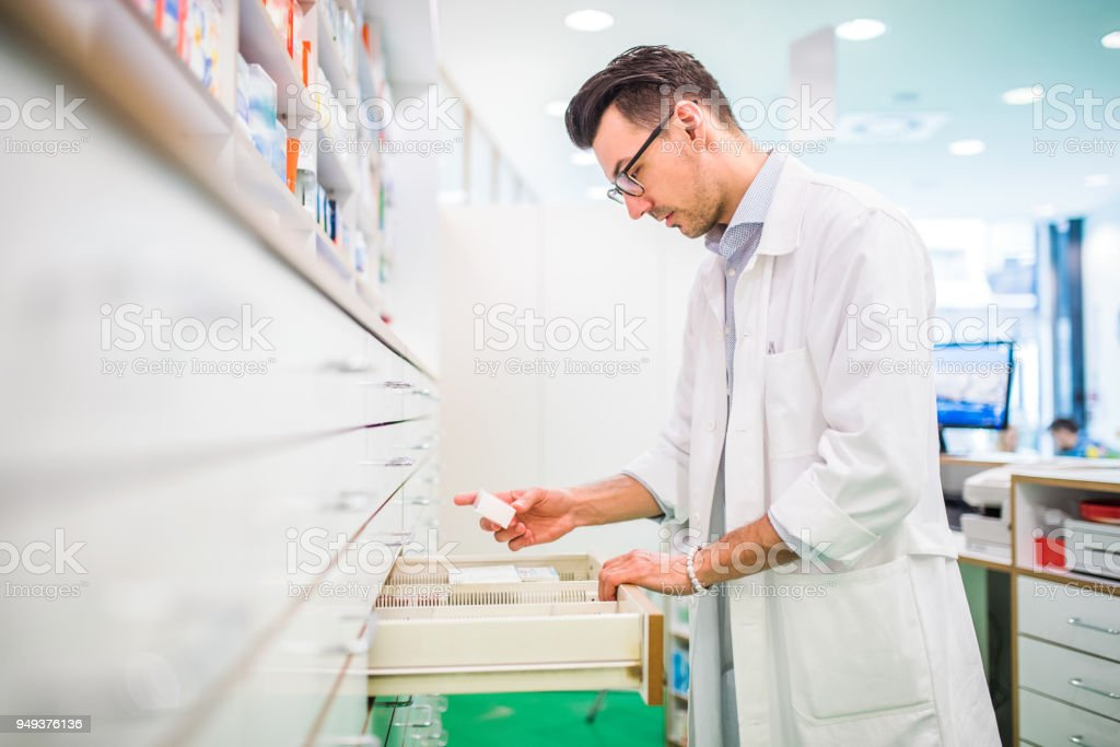 Portrait of a young friendly male pharmacist. stock photo