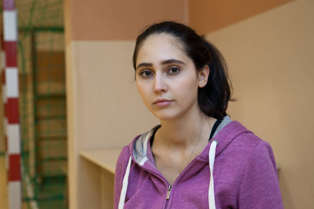 Portrait of a young girl in a school gym stock photo