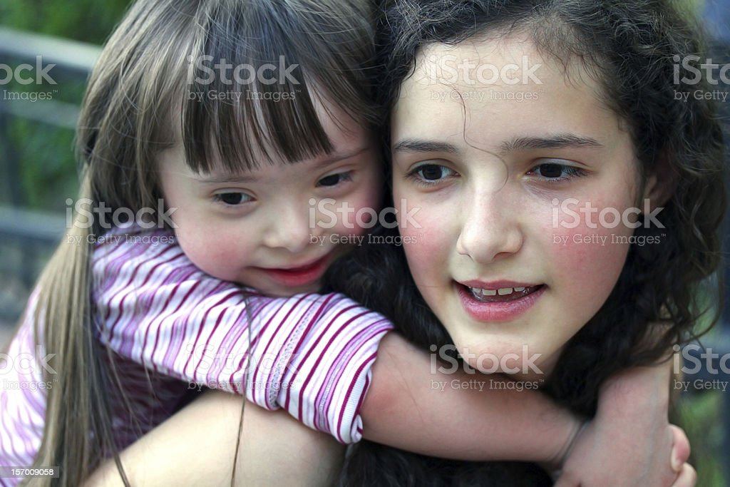 Portrait of a young girl on the back of a teenage girl stock photo