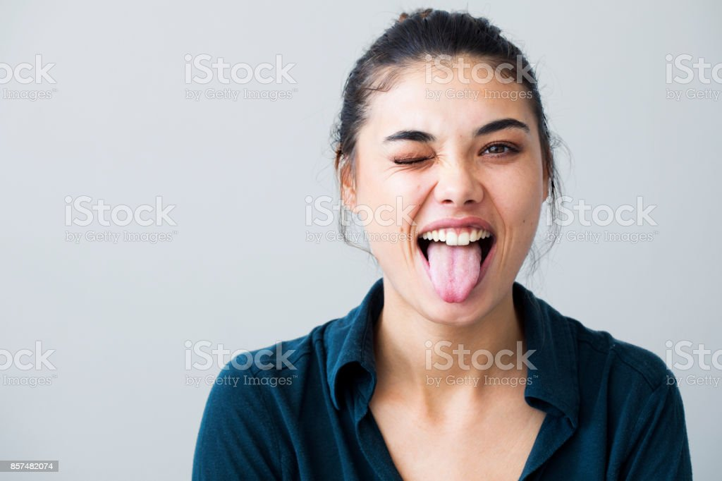 Portrait of a young girl showing her tongue stock photo