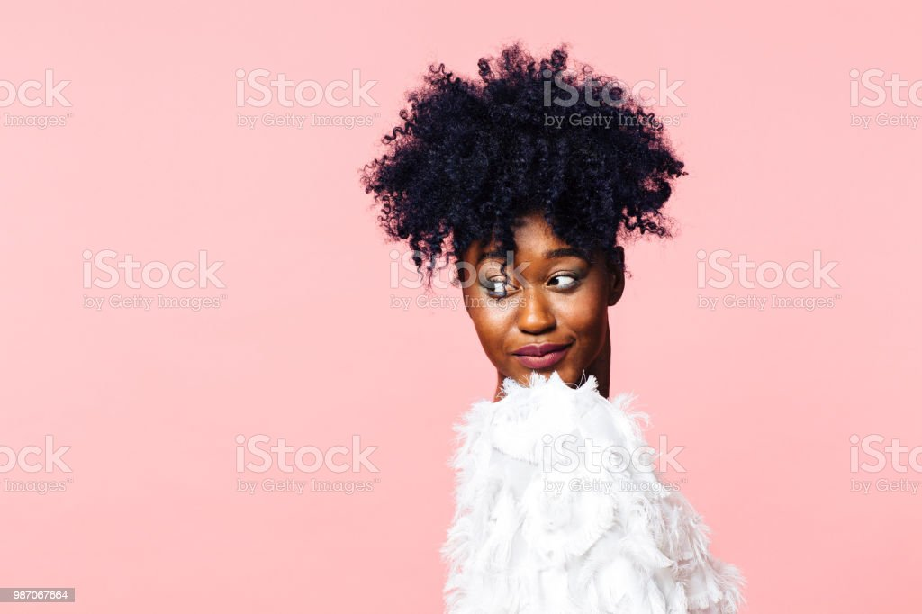 Portrait of a young girl with curly hair ponytail looking to the side stock photo