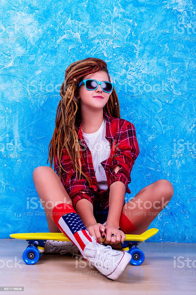 Portrait of a young girl with skateboard stock photo
