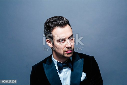 istock Portrait of a young handsome man in a suit, seriously looking at the camera 908127226