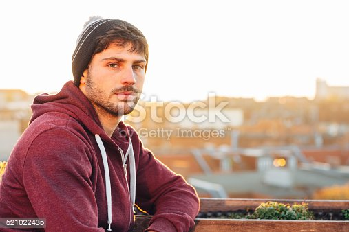 istock Portrait of a young handsome man in the back light 521022435