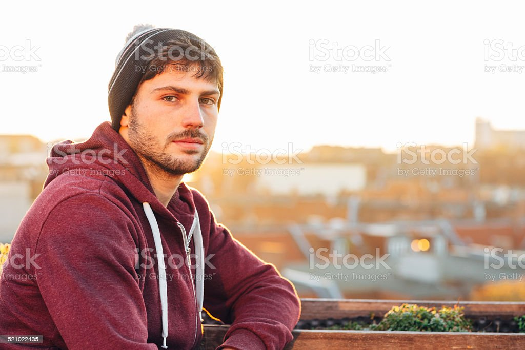 Portrait of a young handsome man in the back light stock photo