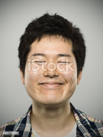 istock Portrait of a young happy japanese man looking at camera 499476690