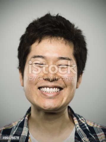 istock Portrait of a young happy japanese man looking at camera 499478678