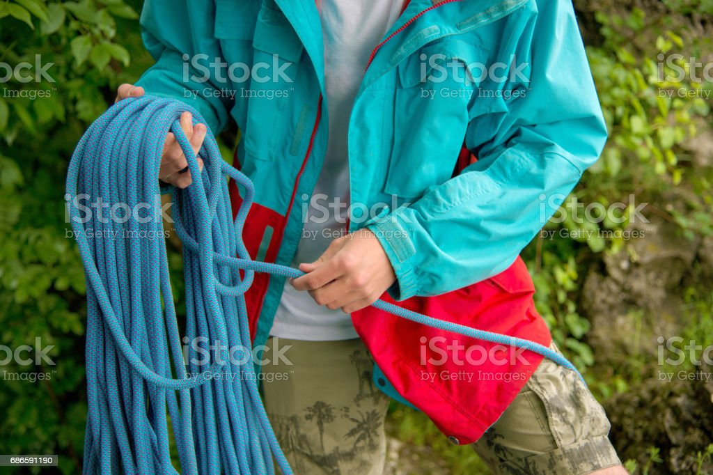 Portrait of a young hipster, training equipment for climbing royalty-free stock photo