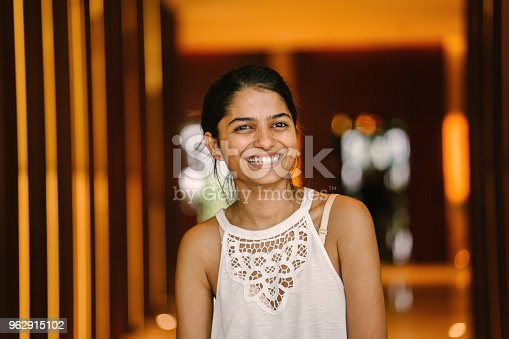 istock Portrait of a young Indian Asian business intern standing in an office lobby. 962915102