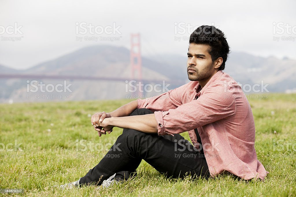 Portrait of a young indian man by Golden Gate Bridge royalty-free stock photo