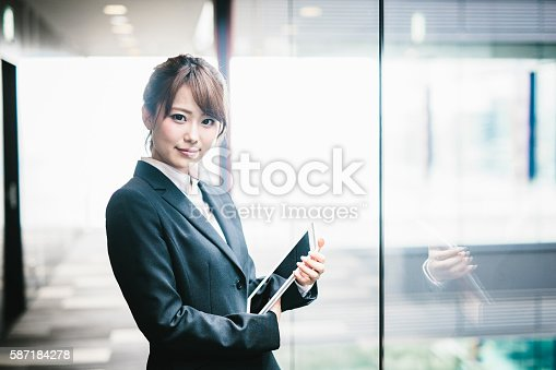 istock Portrait of a Young Japanese Business Woman 587184278