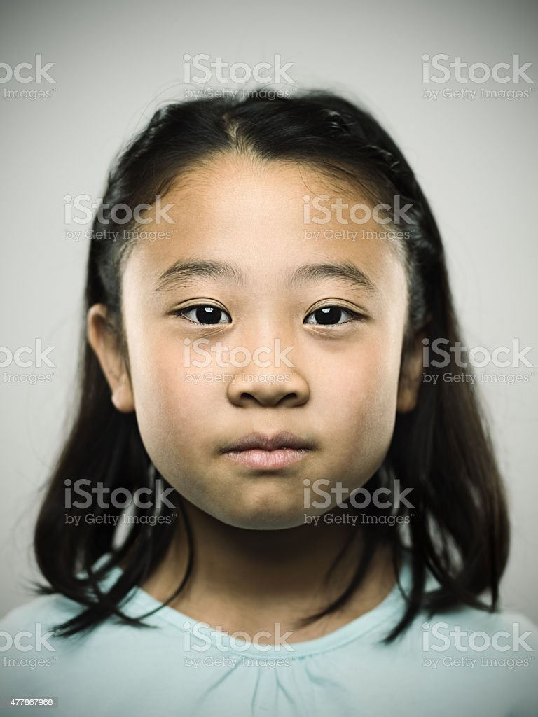 Portrait of a young japanese girl looking at camera. stock photo