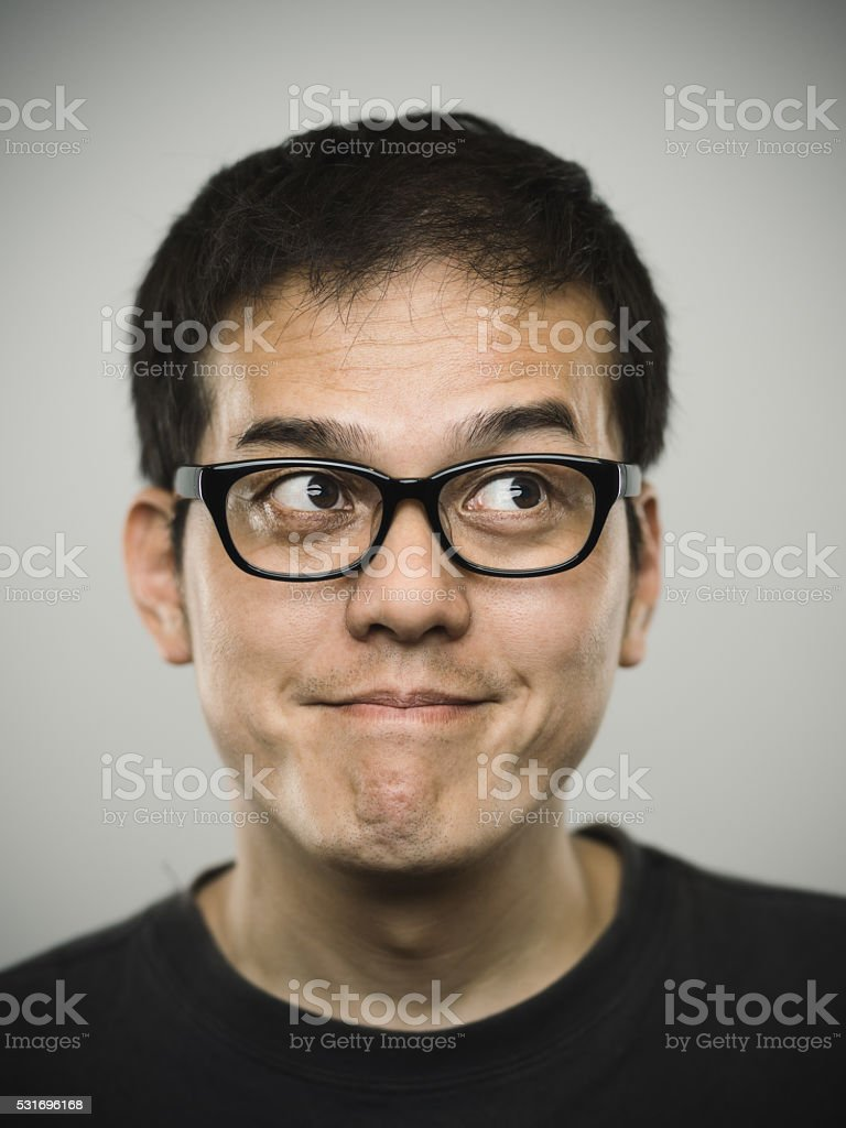 Portrait of a young japanese man looking up. stock photo