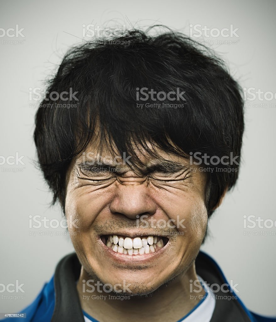 Portrait of a young japanese man under stress stock photo