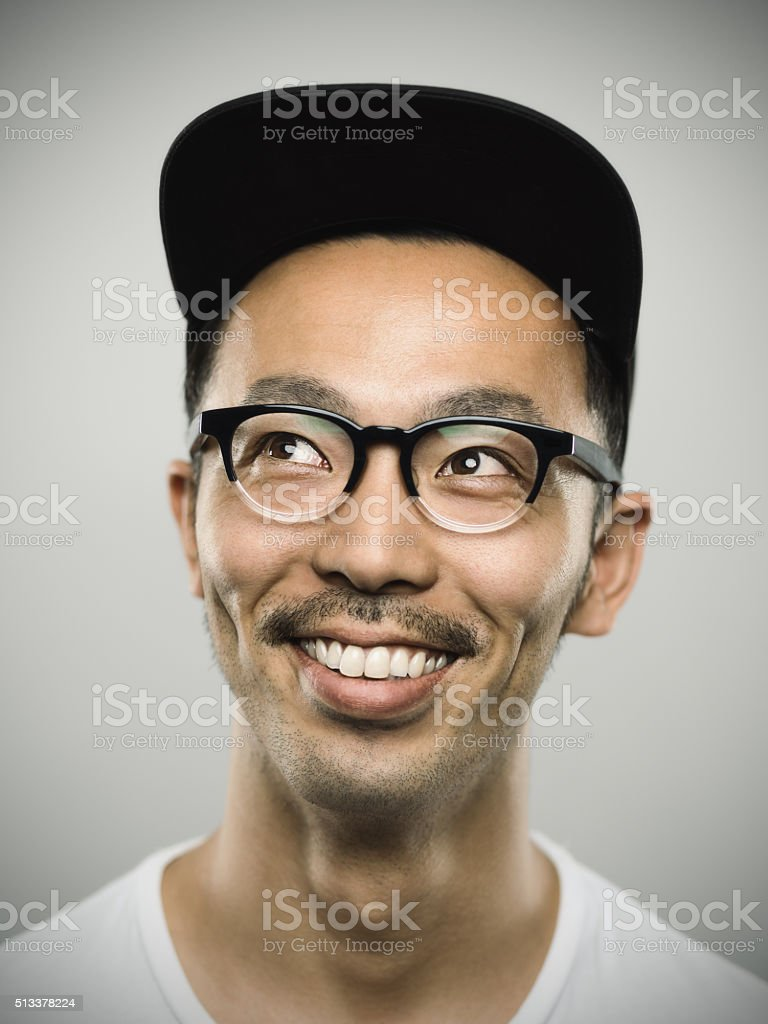 75ddc47df68 Portrait of a young japanese man with big smile royalty-free stock photo