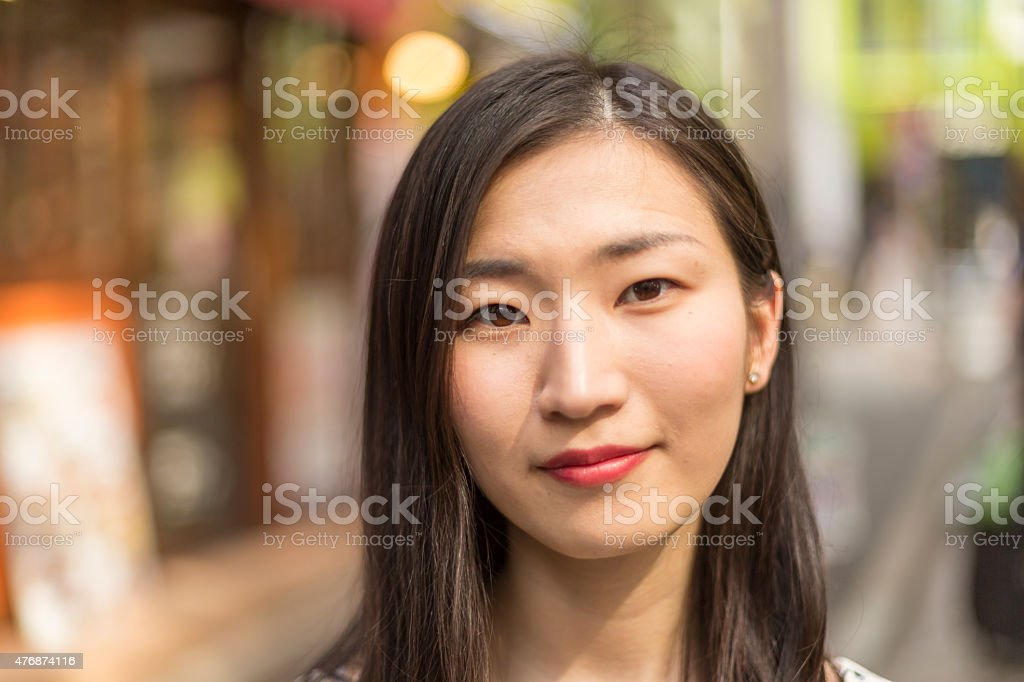 Portrait of a Young Japanese Woman on Streets of Tokyo stock photo