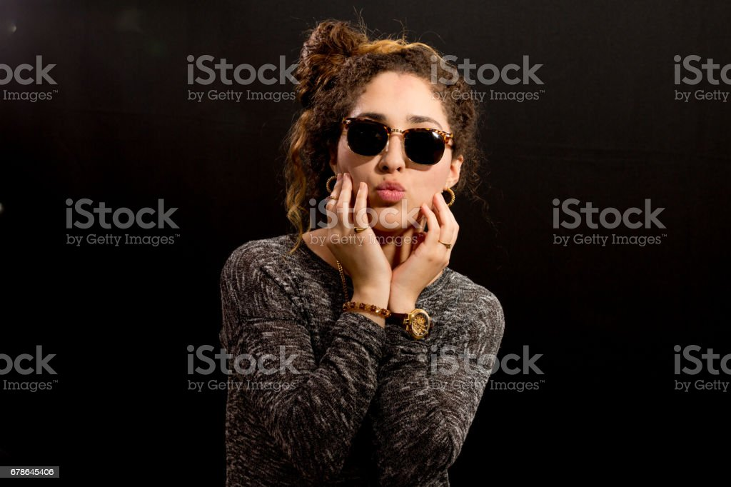 Portrait of a Young Lady Throwing a Kiss stock photo