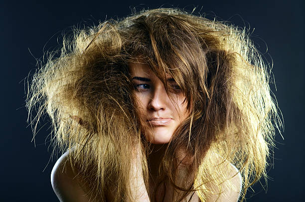 portrait of a young lady with tousled hair - messy hair stock photos and pictures
