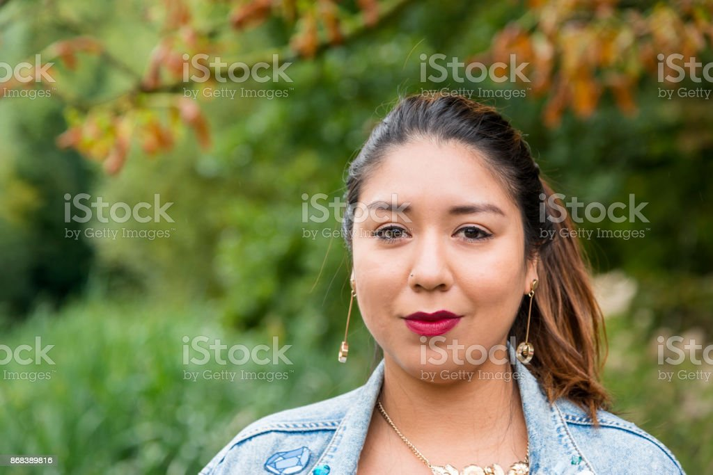 Portrait of a young latin woman looking at camera stock photo