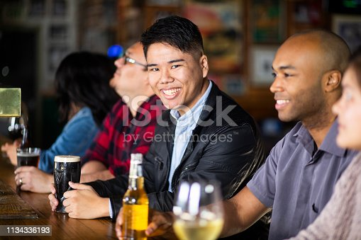 istock Portrait of a young man at a sports bar 1134336193