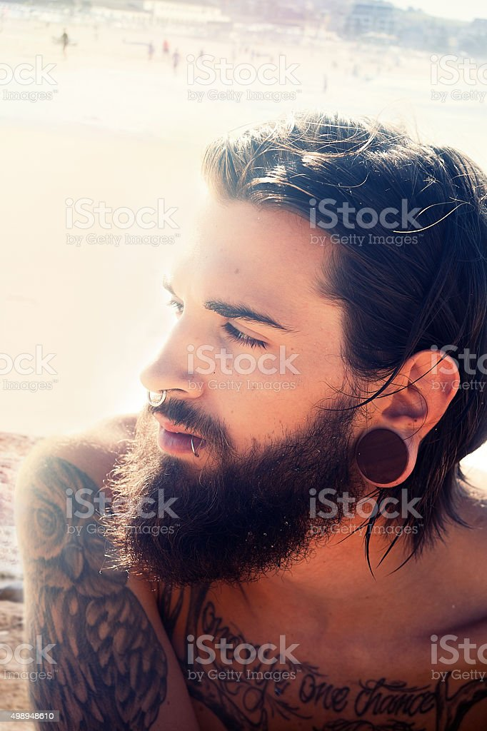 Portrait of a young man at the beach stock photo