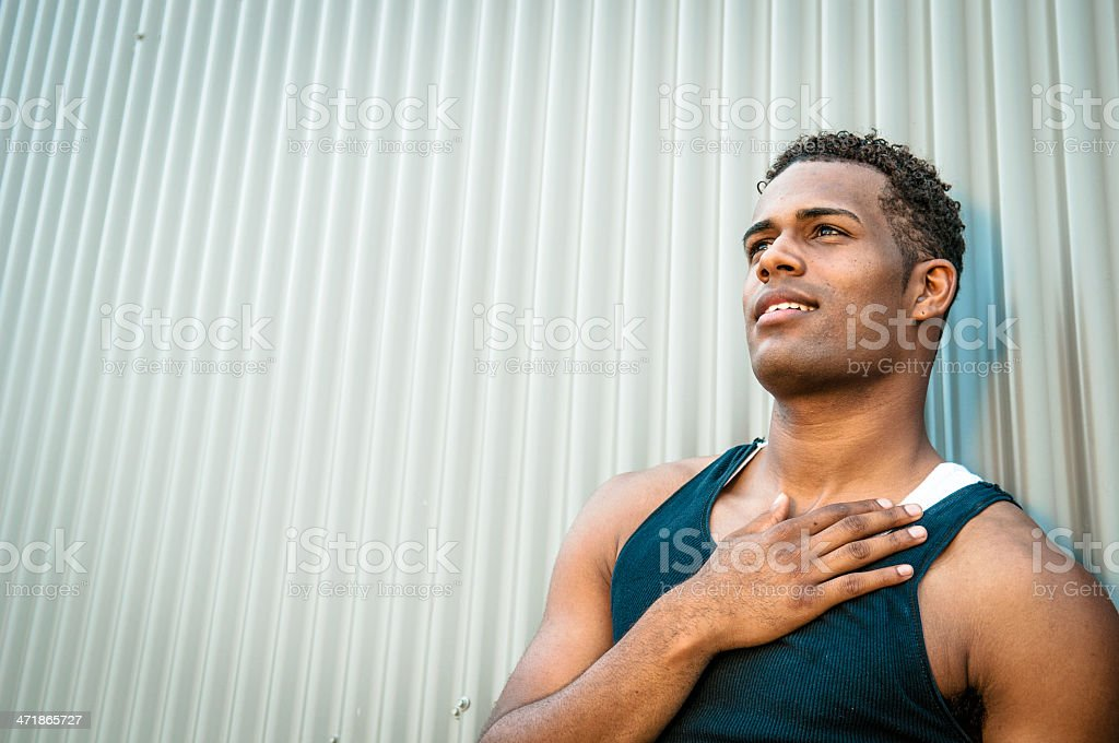 Portrait of a young man, hand on heart stock photo