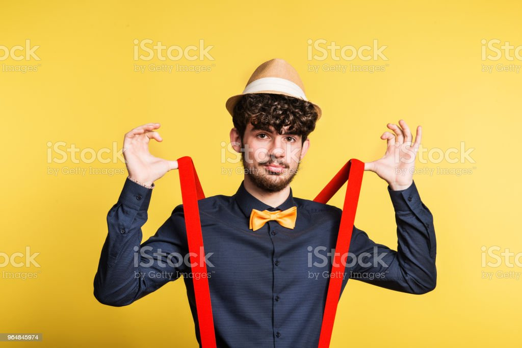 Portrait of a young man in a studio on a yellow background. royalty-free stock photo