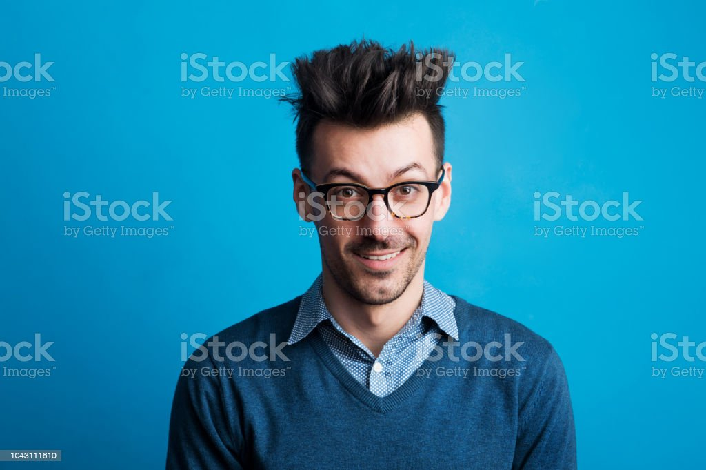 Portrait Of A Young Man In A Studio With Spiky Hairstyle Stock Photo