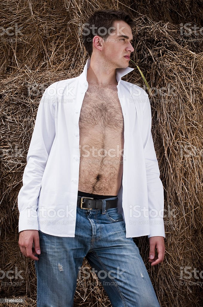 portrait of a young man in field stock photo