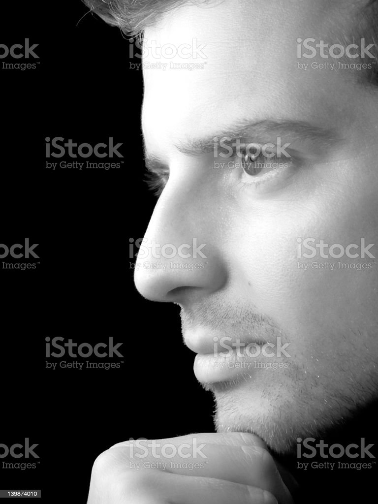 Portrait of a young man looking away in thought royalty-free stock photo