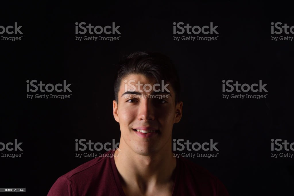 portrait of a young man on black background stock photo