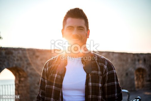 492529287istockphoto Portrait of a young man 880640714