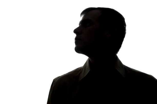 Portrait of a young man, side view stock photo