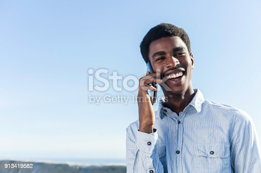 492529287istockphoto Portrait of a young man talking on his mobile phone. 913419582