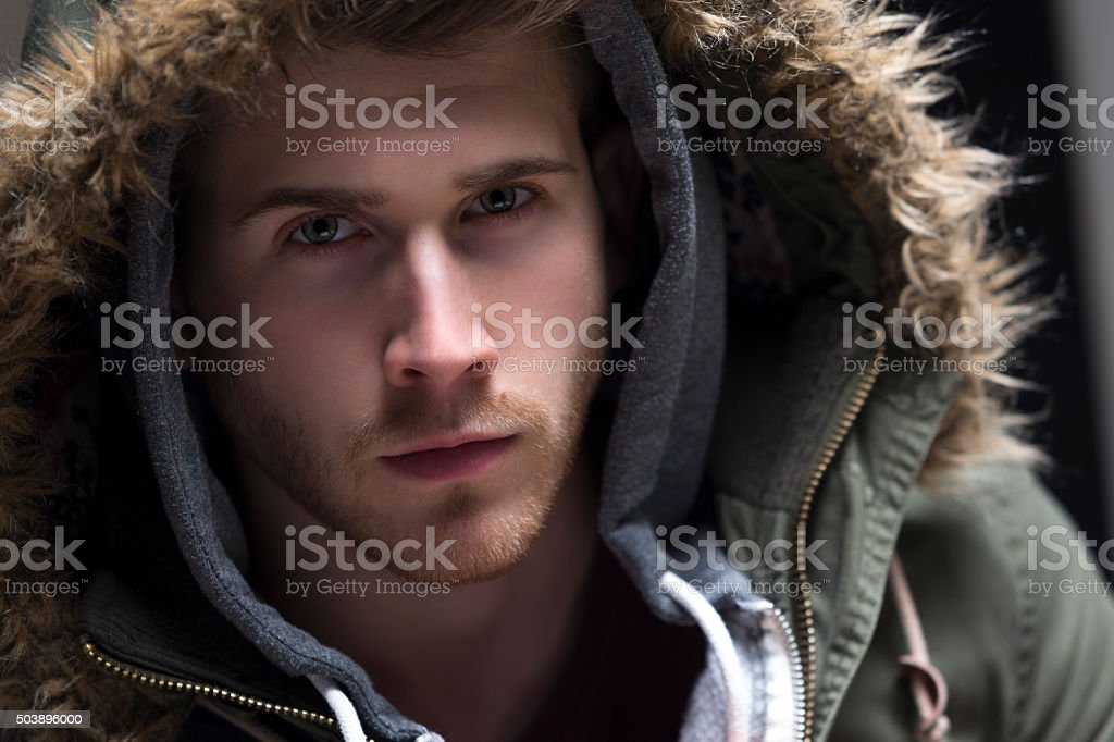Portrait of a young man with his hood up stock photo