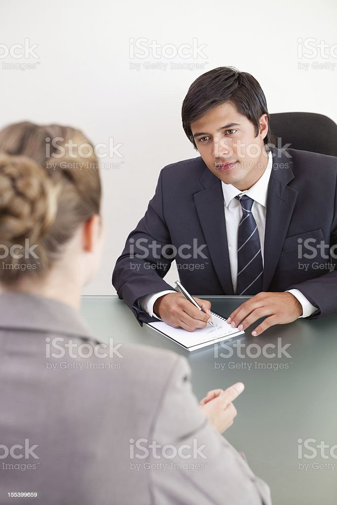 Portrait of a young manager discussing business with his employee royalty-free stock photo