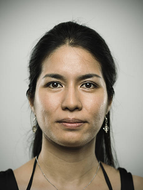 portrait of a young mixed race woman looking at camera - peruvian ethnicity stock pictures, royalty-free photos & images