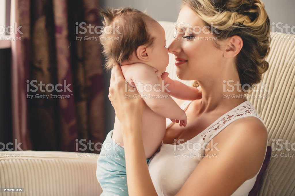 Portrait of a young mother and newborn son at home foto de stock royalty-free